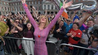 DUBLIN, IRELAND - MAY 23:  Drag queen artist and Yes campaign activist, Panti Bliss joins supporters in favour of same-sex marriage celebrate and cheer as thousands gather in Dublin Castle square awaiting the referendum vote outcome on May 23, 2015 in Dublin, Ireland. Voters in the Republic of Ireland are taking part in a referendum on legalising same-sex marriage on Friday. The referendum was held 22 years after Ireland decriminalised homosexuality with more than 3.2m people being asked whether they want to amend the country's constitution to allow gay and lesbian couples to marry.  (Photo by Charles McQuillan/Getty Images)