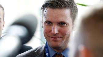 """Richard Spencer, a leader and spokesperson for the so-called """"alt-right"""" movement, speaks to the media at the Conservative Political Action Conference (CPAC) in National Harbor, Maryland, U.S., February 23, 2017.      REUTERS/Joshua Roberts"""