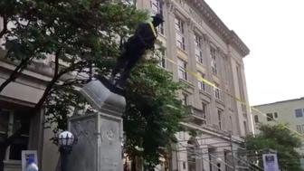 A confederate monument is toppled in Durham North Carolina