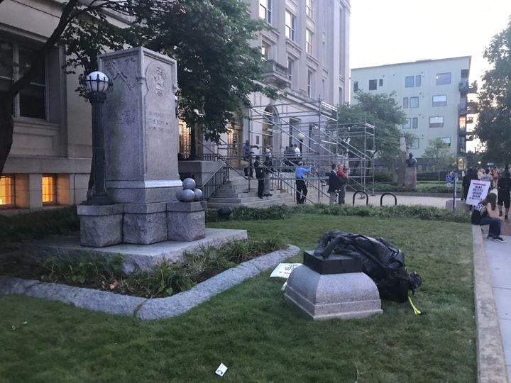 The toppled Confederate monument lies on the grass outside Old Durham County Courthouse.
