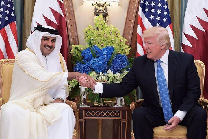 US president Donald Trump, and Qatar's Emir Sheikh Tamim Bin Hamad Al-Thani