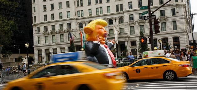 Trumpy the Ratstands at the corner of Fifth Avenue and 59th Street, a few blocks from
