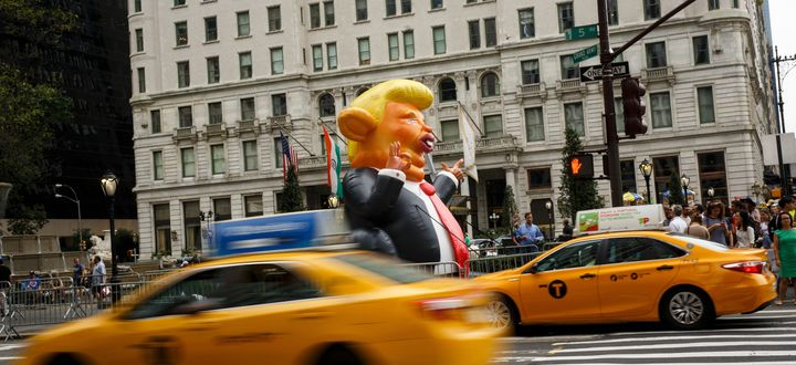Trumpy the Rat stands at the corner of Fifth Avenue and 59th Street, a few blocks from Trump Tower.