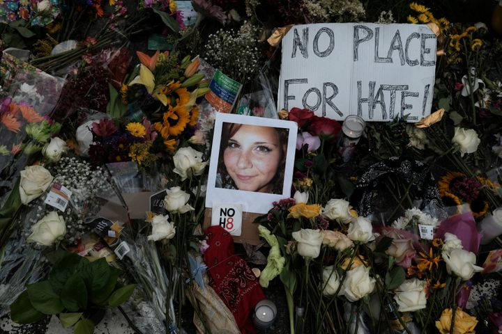 A photo of Heather Heyer placed among flowers left at the scene of where she died, after a car plowed into her and other coun