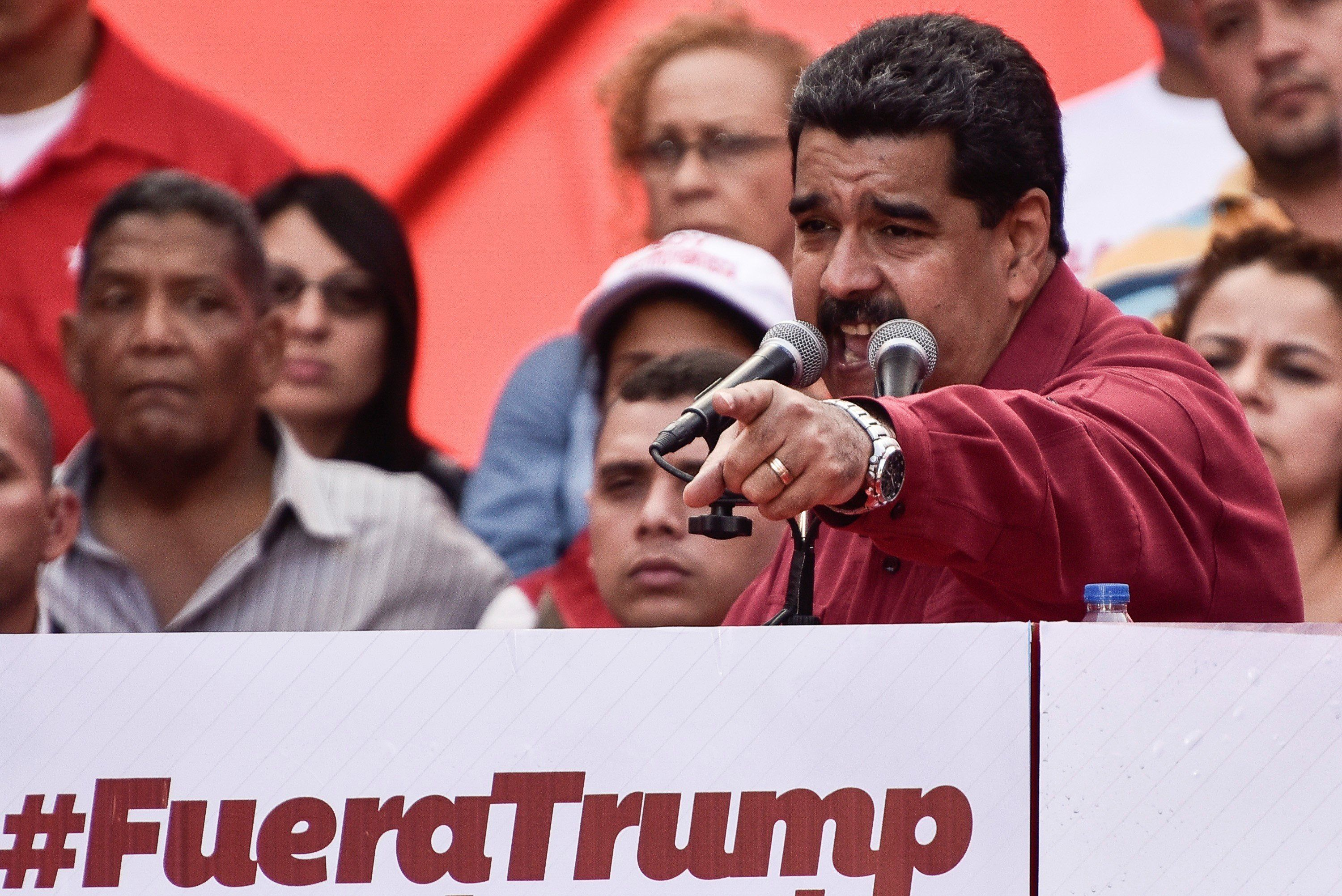 CARACAS, VENEZUELA - AUGUST 14: Venezuela's President Nicolas Maduro (R) gestures as he speaks during a rally supporting him and opposing U.S. President Donald Trump, in Caracas, on August 14, 2017. (Photo by Carlos Becerra/Anadolu Agency/Getty Images)
