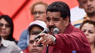 CARACAS, VENEZUELA - AUGUST 14: Venezuela's President Nicolas Maduro (R) gestures as he speaks during a rally supporting him and opposing U.S. President Donald Trump, in Caracas, on August 14, 2017. (Photo by Carlos Becerra/Anadolu Agency/Getty Images)