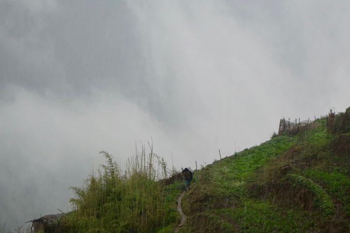 <p><em>A Nepali villager caught in a hailstorm.</em></p>