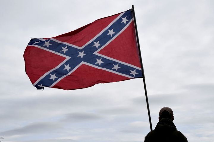 Trevor Jackson displays a Confederate flag during a rally held by Sons of Confederate Veterans in Shawnee, Oklahoma, U.S. Mar