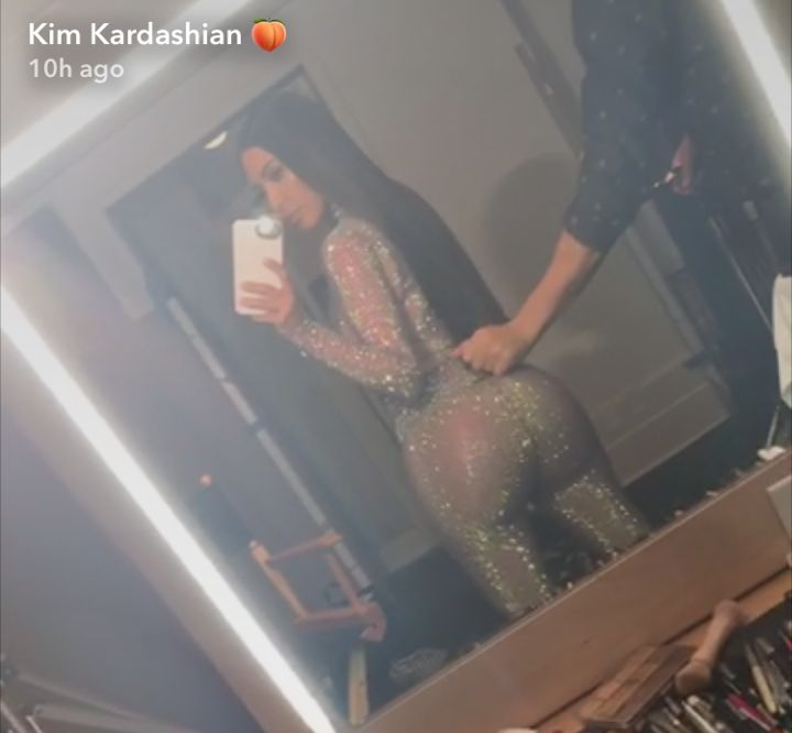 According to her Snapchat videos prior to putting on the glittery ensemble, the reality star wore nude shapewear underneath the bodysuit.<strong>&nbsp;</strong>