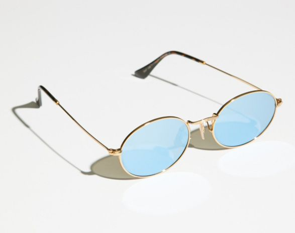 "<a href=""https://www.freepeople.com/shop/90s-kid-oval-sunnies/"" target=""_blank"">Shop them here</a>."