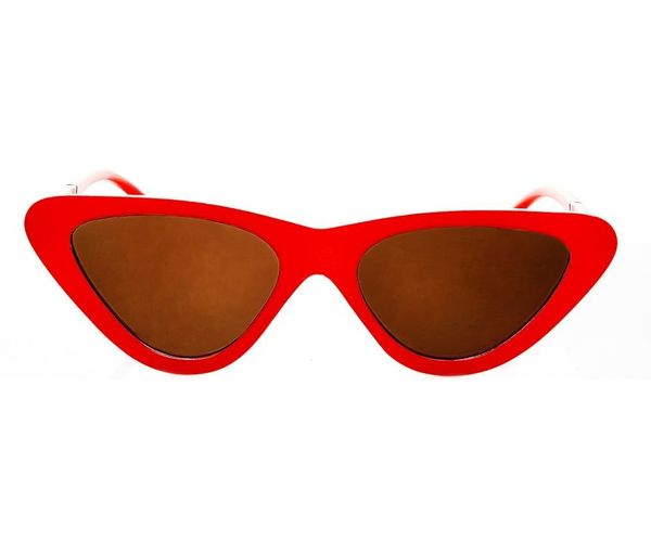 "<a href=""http://us.topshop.com/en/tsus/product/polly-90s-pointy-cat-eye-sunglasses-6749091"" target=""_blank"">Shop them here</a"