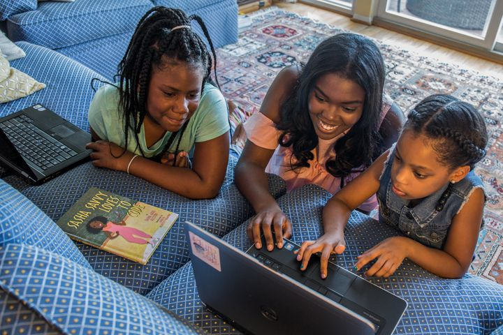 Sasha Ariel Alston (middle), a teen author, wrote a book titled <i>Sasha Savvy Loves to Code&nbsp;</i>to inspire girls to pursue STEM.