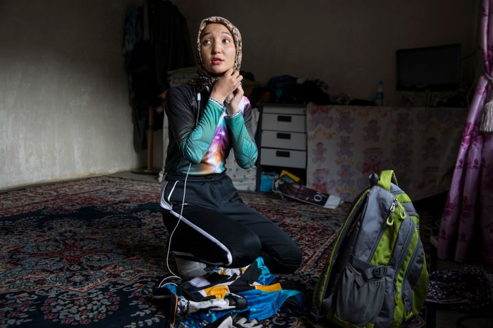 Photographer Paula Bronstein captured 23-year-old Zakia getting ready for a bike ride. It's frowned upon for women in Afghanistan to ride bicycles, but Zakia defies those stereotypes.