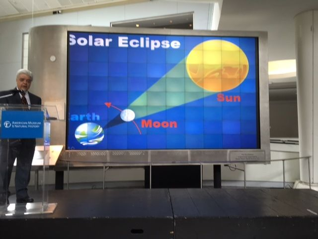 Joe Rao, Hayden Planetarium associate explains the line up of the Earth , moon and sun that makes a total eclipse posible