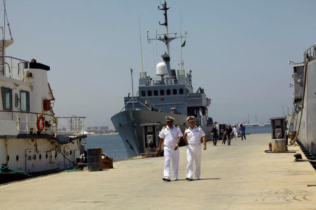 Navy troopers walk in front of Italian navy ship Tremiti in a dock in Tripoli, Libya August 10,