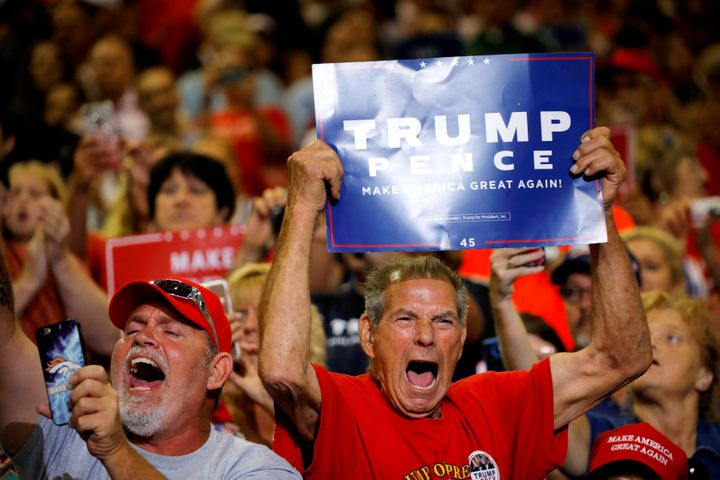 Local residents react as President Donald Trump arrives at a rally in Huntington, West Virginia, on Aug. 3, 2017.