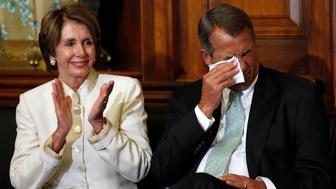 "House Democratic leader Nancy Pelosi (L) applauds as Speaker of the House John Boehner (R-OH) reacts during an event posthumously awarding the Congressional Gold Medal to Capitol fresco painter Constantino Brumidi (1805-1880), ""in recognition of his many artistic contributions to the United States Capitol'' in the U.S. Capitol, Washington July 11, 2012.  REUTERS/Kevin Lamarque  (UNITED STATES - Tags: POLITICS SOCIETY)"