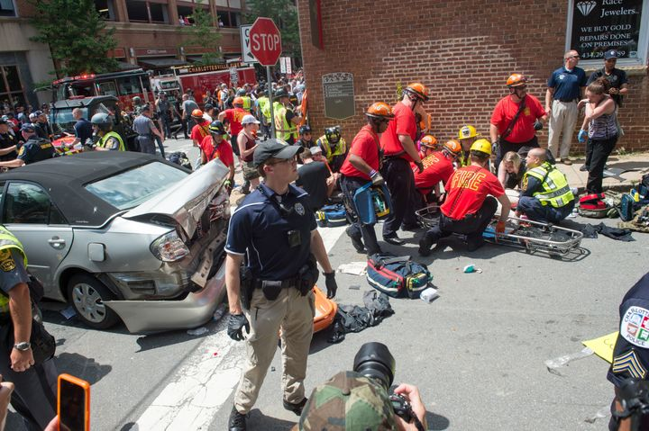 A woman receives first aid after a car ran into a crowd of people in Charlottesville, Virginia, on Aug. 12, 2017.