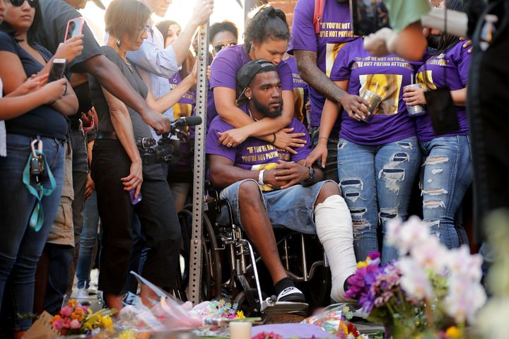 "Marcus Martin (center), who was injured when a car plowed into a crowd of people protesting against the white supremacist ""Un"
