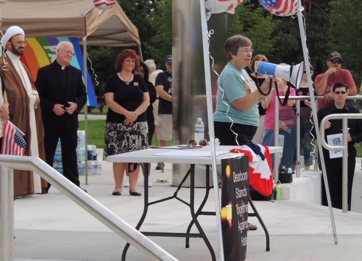"Rev. Fran Hayes of the Littlefield Presbyterian Church speaks at the ""Rally Against Hate"" in Dearborn, Mich."