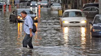 Pedestrians make their way through the flooded streets of Miami on Tuesday, Aug. 1, 2017. (Carl Juste/Miami Herald/TNS via Getty Images)