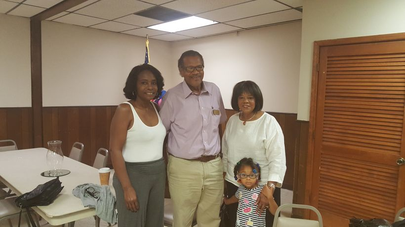J.W. Cleary, head of the Paducah NAACP, poses with friends and family at the Eighth of August prayer breakfast.