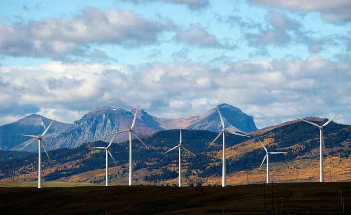 Windmills generate electricity in the foothills of the Rocky Mountains near the town of Pincher Creek, Alberta, Canada.