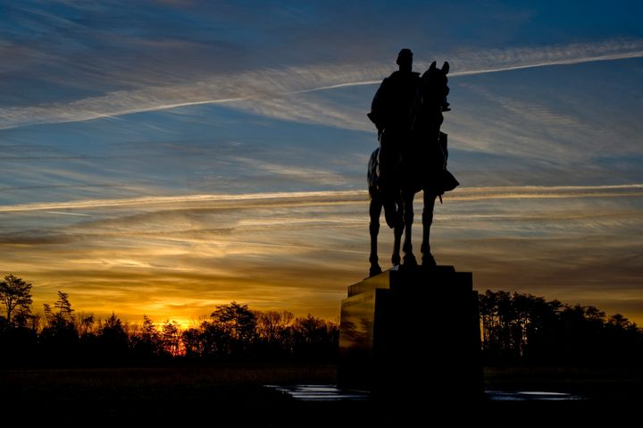 "At sunrise the statue of Gen. Thomas J. ""Stonewall"" Jackson stands over Manassas National Battlefield Park in Virginia. Many"