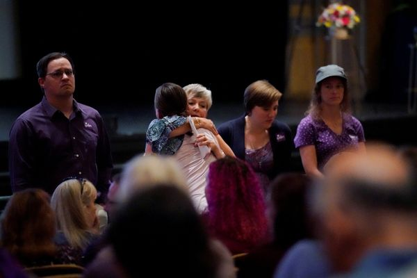 Mourners inside the Paramount Theater wear purple, as Heyer's family had requested. Purple was her favorite color.