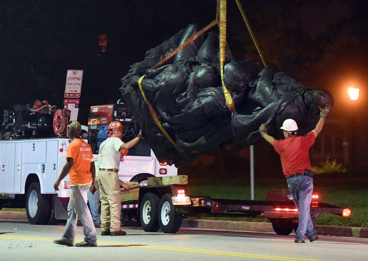Workers remove a monument dedicated to the Confederate Women of Maryland in Baltimore.