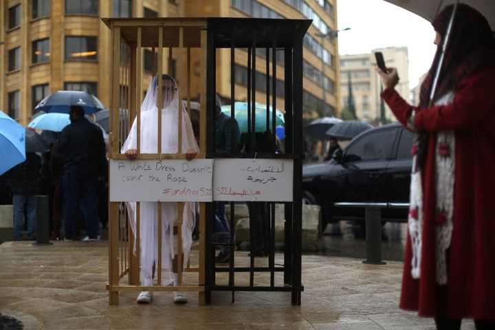 An activist from Abaad, a women's rights group in Lebanon, protests a law that shields rapists from prosecution on the condit