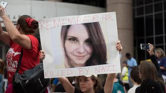 MINNEAPOLIS, MN - AUGUST 14:  A protesters carries an image of Heather Heyer during a demonstration against racism and the violence over the weekend in Charlottesville, Virginia on August 14, 2017 in Minneapolis, Minnesota. Protesters estimated at more than 1,000 blocked streets and light rail during the action.  (Photo by Stephen Maturen/Getty Images)