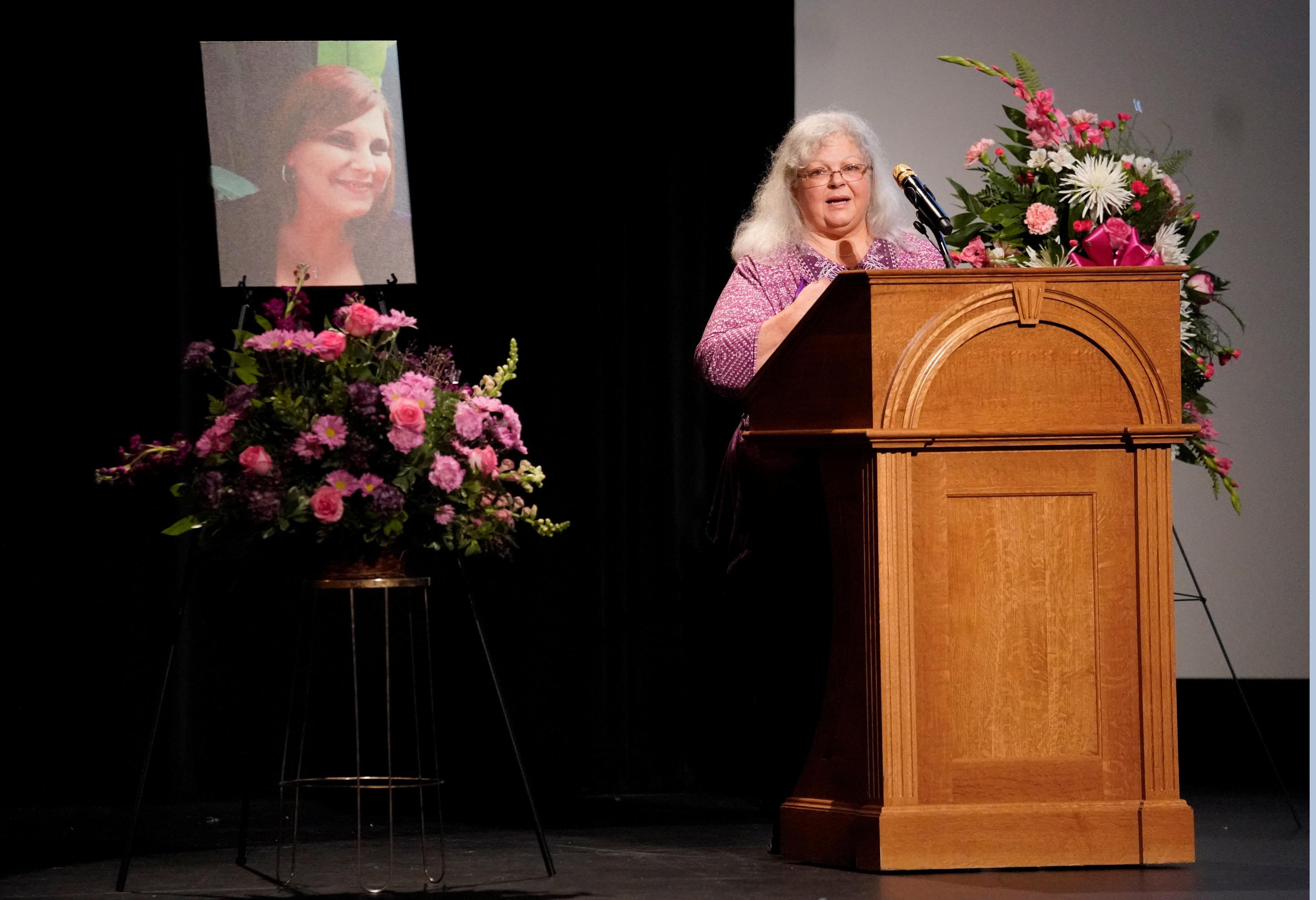 Susan Bro, Heyer's mother, speaks during her service.