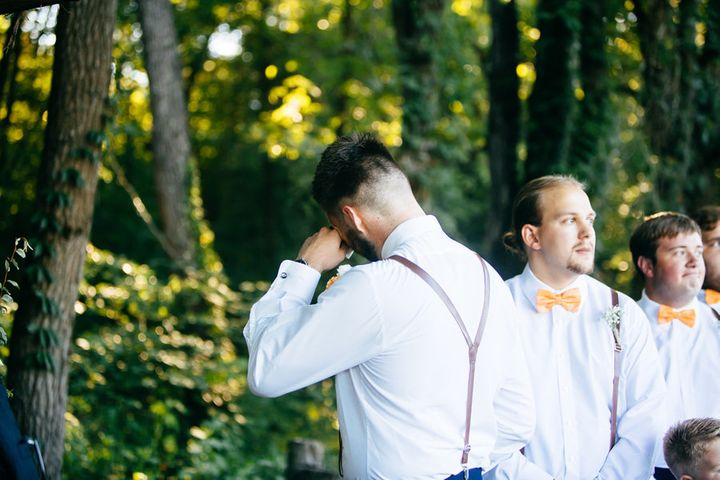 Micah's best man prompted him to turn around as his bride came down the aisle.