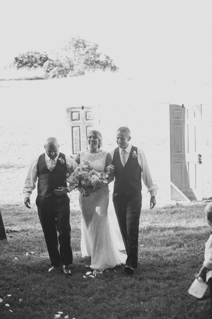 Bride Bailey Baker'sdad and stepdad walked her down the aisle.