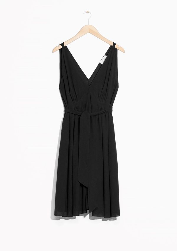 """The little black dress to end all little black dresses.<a href=""""http://www.stories.com/us/Shop_by/Our_favourite_dresses"""
