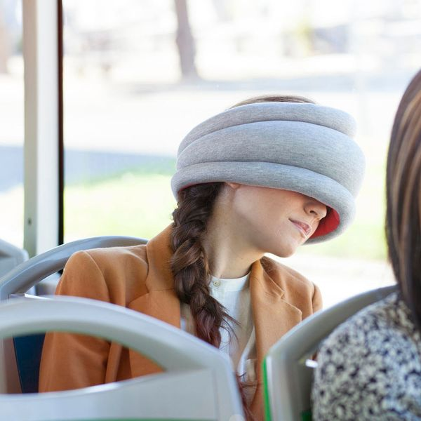 We're obsessed with this slip-on napping pillow, and we're sure the commuter or traveler in your life will be just as obsesse