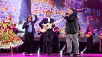 ANAHEIM, CA - JULY 14:  (L-R) Actor Anthony Gonzalez and musician Federico Ramos of COCO and Chief Creative Officer of Pixar and Walt Disney Animation Studios John Lasseter took part today in the Walt Disney Studios animation presentation at Disney's D23 EXPO 2017 in Anaheim, Calif. COCO will be released in U.S. theaters on November 22, 2017.  (Photo by Jesse Grant/Getty Images for Disney)