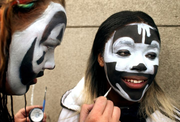 Two teenagers paint their faces before an Insane Clown Posse concert in Denver.