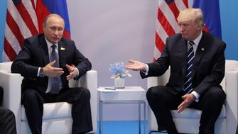 Russia's President Vladimir Putin talks to U.S. President Donald Trump during their bilateral meeting at the G20 summit in Hamburg, Germany July 7, 2017.    REUTERS/Carlos Barria