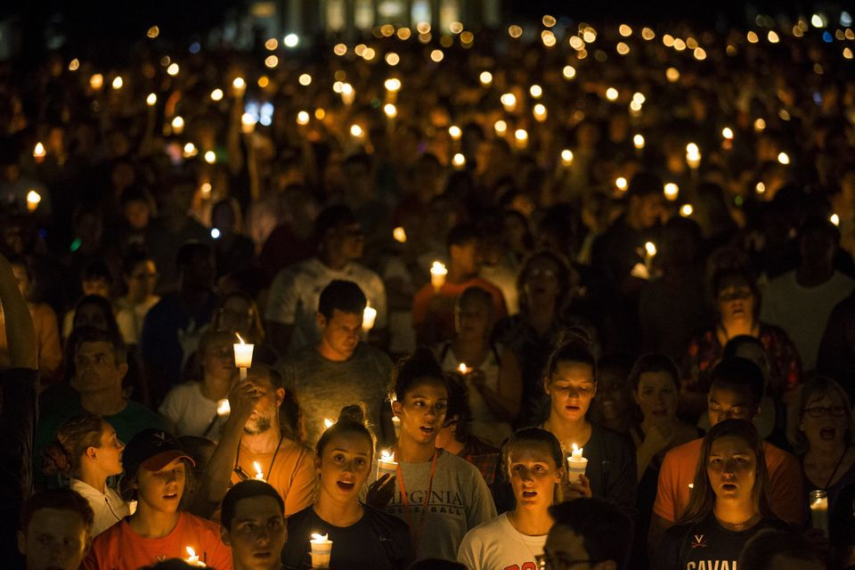 On Aug. 16, 2017, demonstrators with candles march along the path that white supremacists took days earlierwith torches