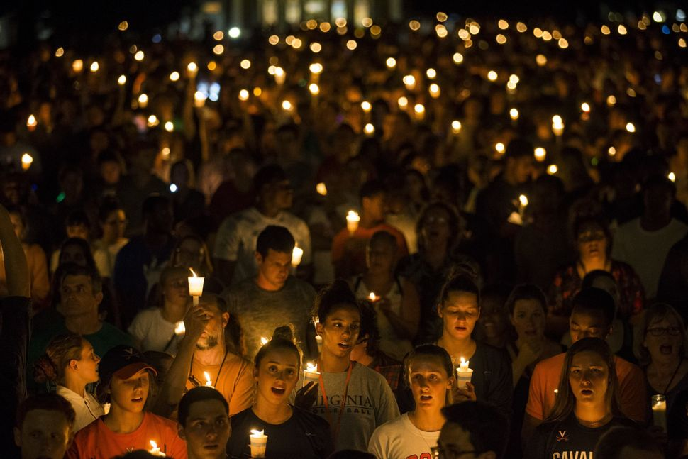 On Aug. 16, 2017, demonstrators with candles march along the path that white supremacists took days earlier with torches
