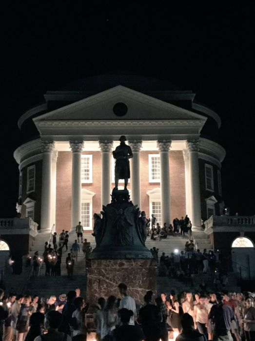 Demonstrators lay candles at the base of the Thomas Jefferson statue at the University of Virginia campus.