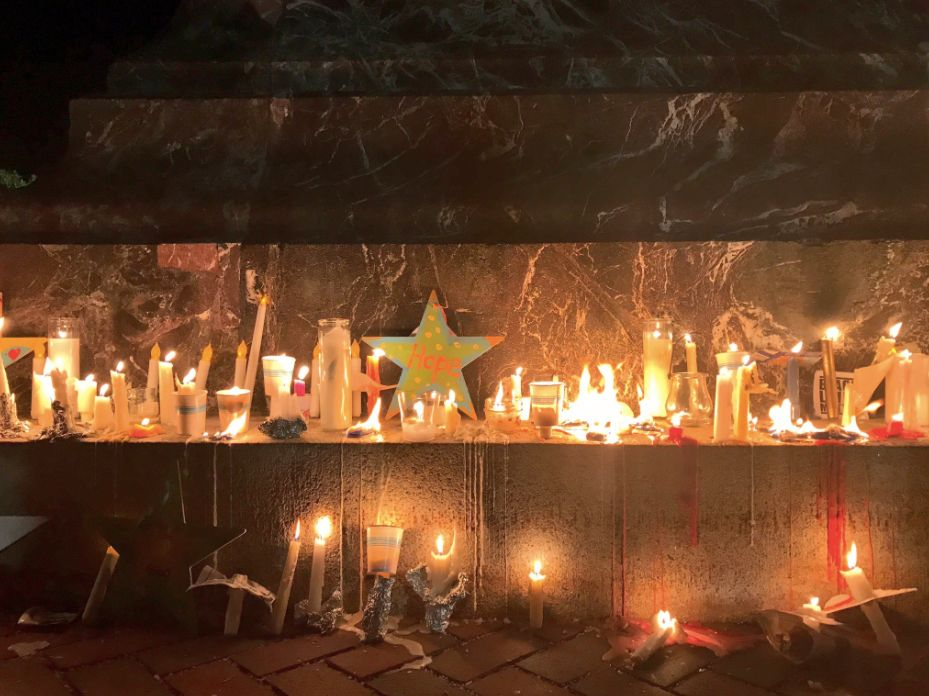 "The candles were accompanied by handwritten messages. One, written on a star, said ""Hope."""