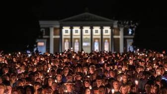 CHARLOTTESVILLE, VA - AUGUST 16: Hundreds of people march peacefully with lit candles across the University of Virginia campus on Wednesday, August 116, 2017, in Charlottesville, VA, in the wake of violence in the city and against torch-lit white nationalist parade the same campus last Friday night. Students and residents gathered at the universitys Rotunda in Charlottesville to sing together for an evening vigil that stood in stark contrast to last weeks torch-lit march of white supremacists. (Photo by Salwan Georges/The Washington Post via Getty Images)