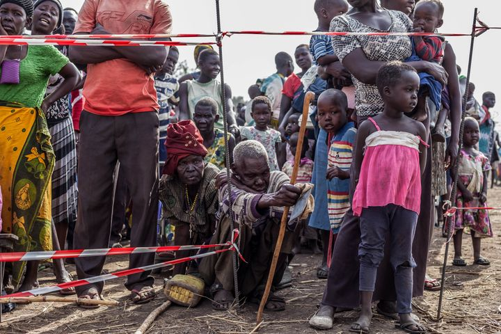 Refugees wait in line at the entrance of the medical post operated by Medical Teams International at Palorinya refugee settle