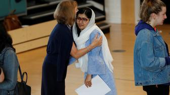 Malala Yousefzai is congratulated after collecting her 'A' level exam results at Edgbaston High School for Girls in Birmingham, Britain August 17, 2017. REUTERS/Darren Staples