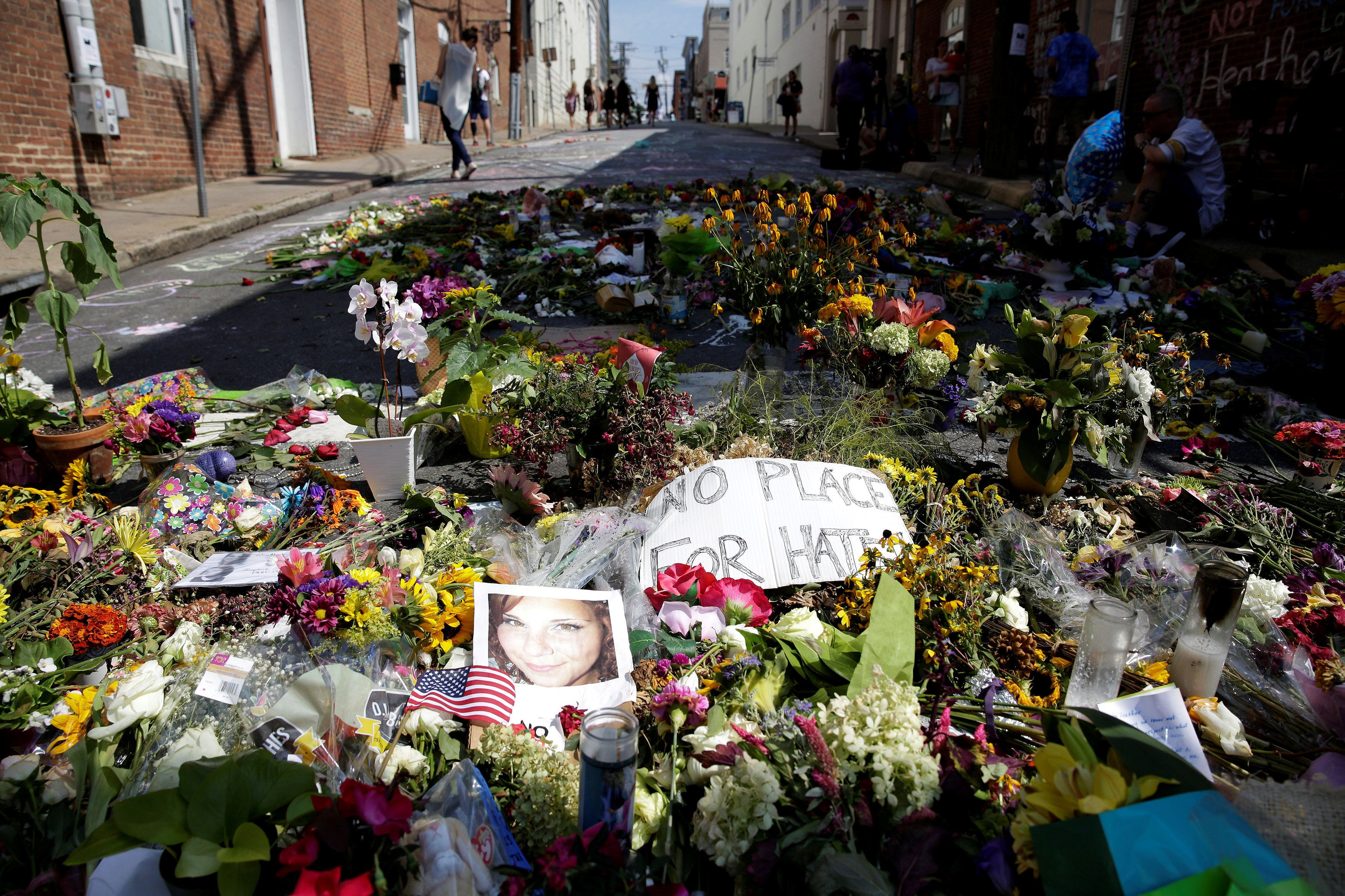 Flowers are pictured on the street where Heather Heyer was killed when a suspected white nationalist crashed his car into anti-racist demonstrators in Charlottesville, Virginia, U.S., August 16, 2017.   REUTERS/Joshua Roberts     TPX IMAGES OF THE DAY