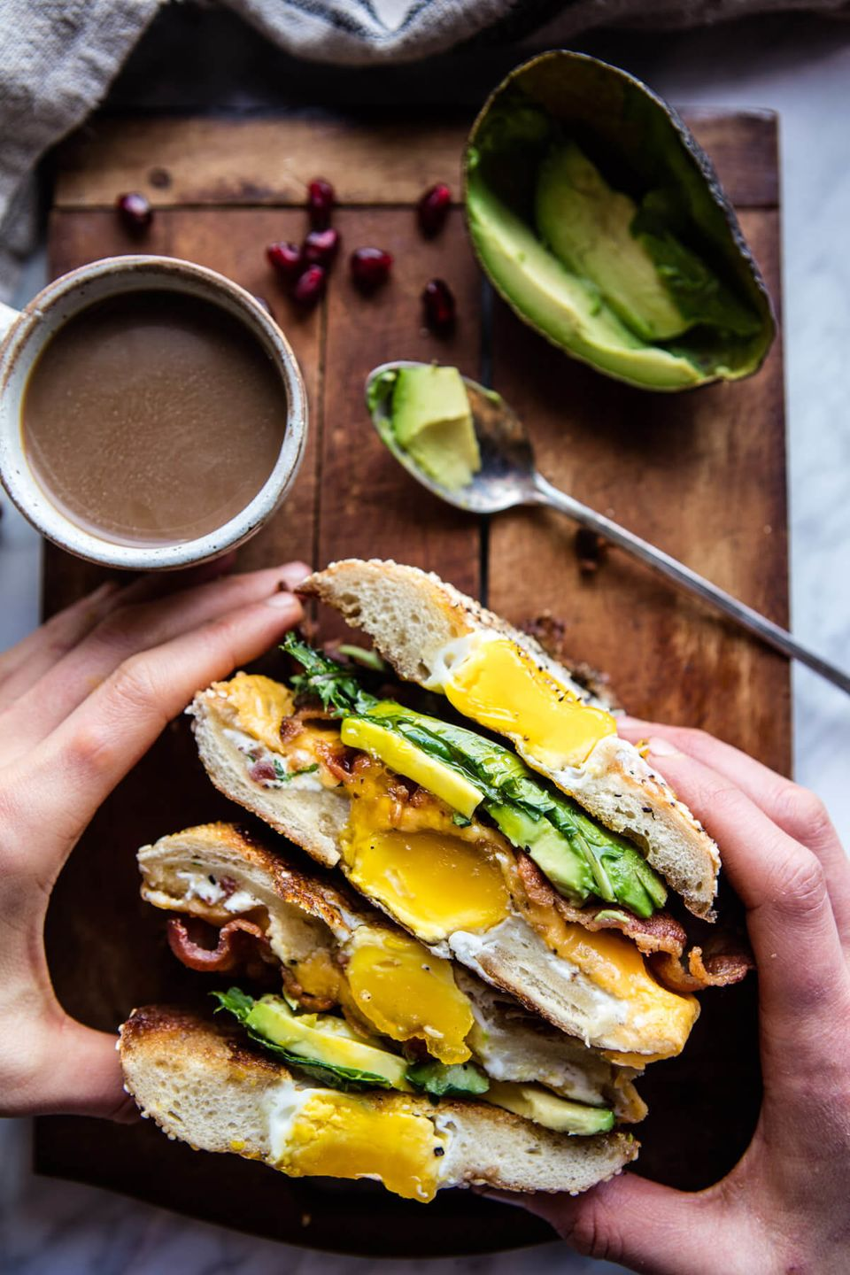 """<strong>Get the <a href=""""https://www.halfbakedharvest.com/egg-in-a-hole-avocado-bacon-egg-and-cheese-bagel/"""" target=""""_blank"""">"""