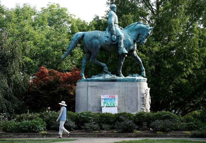 A sign on the statue of Gen. Robert E. Lee calls for the park to be renamed for Heather Heyer, who was killed at in a far-rig